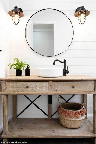 Rustic bathroom renovation with black wall lights