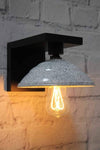 Sleek black wooden wall sconce with exposed bulb on vintage reproduction bakelite speckled shade
