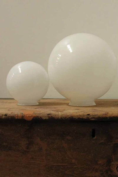 Small six inch and medium 10 inch size glass balls in opal