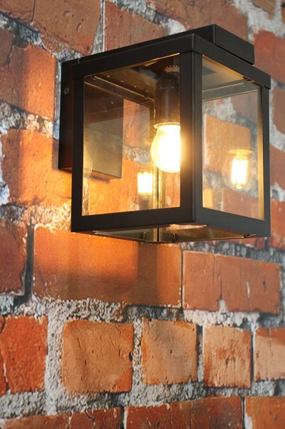 Square outdoor wall light with steel frame and glass panels