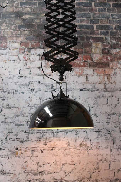 steel shade with porcelain enamel. Large black pendant light. Large scissor arm. Use over tables or in bars and cafe lighting fitouts.