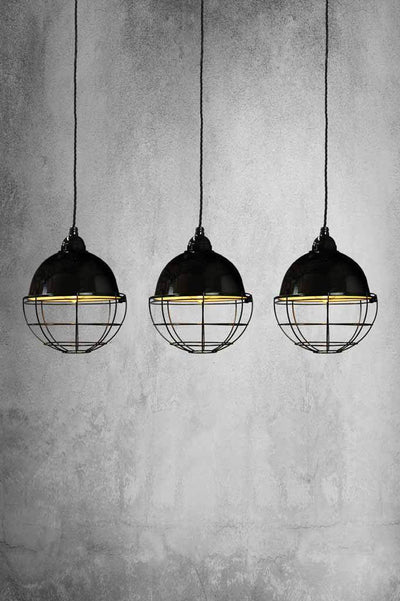 Three classic style dome pendants which hang from a linear rectangle ceiling rose.