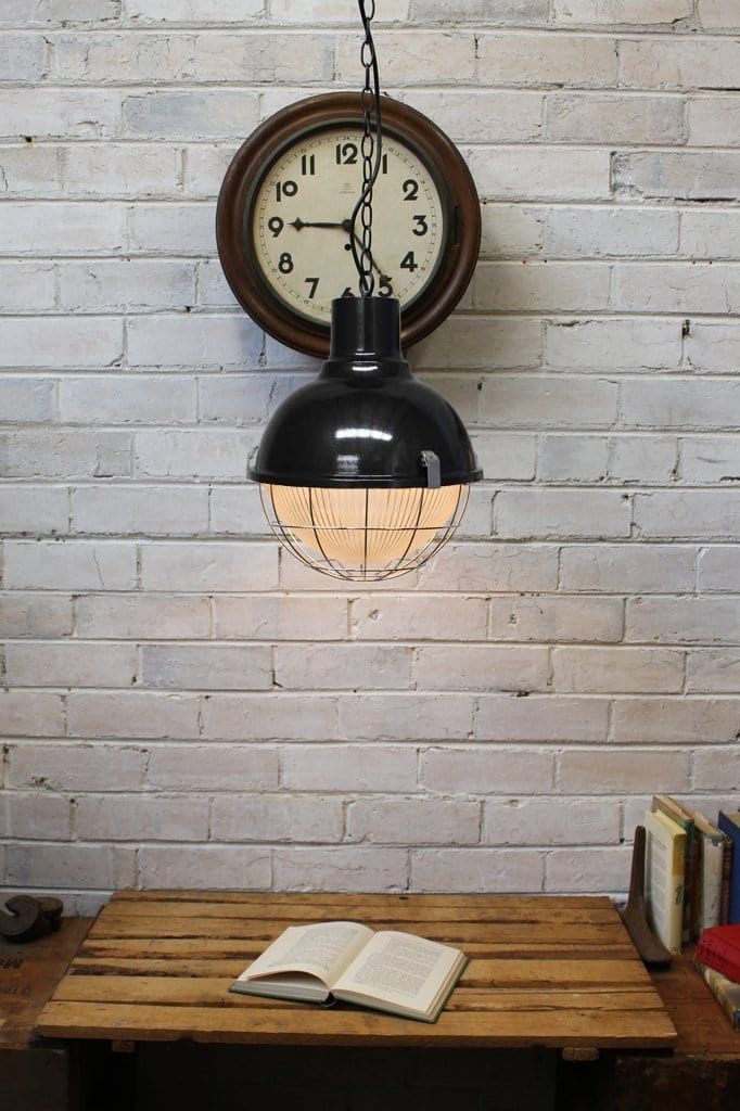 Vintage industrial style pendant light. hanging ceiling light with industrial cage. barber shop or cafe lighting