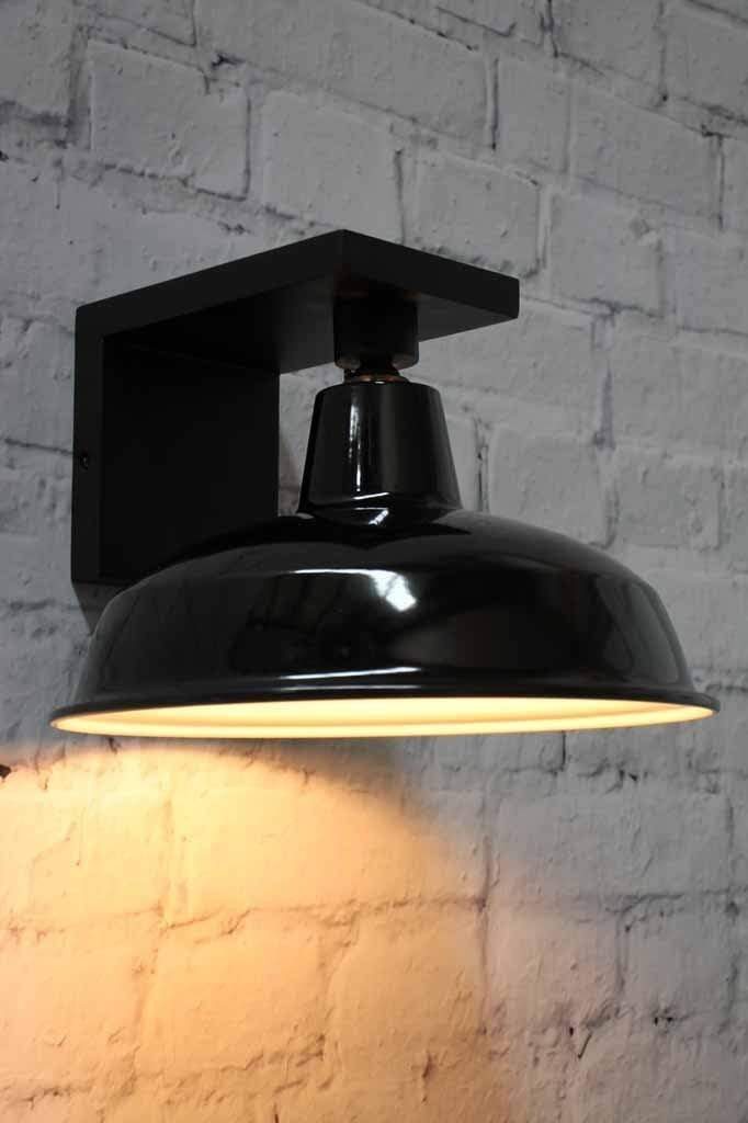 Wooden wall lamp with matt black on polished black effect perfect for contemporary living
