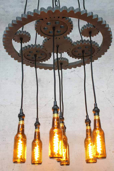wooden fixture in the shape of machinery gears with seven pendant light cords