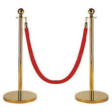 brass stanchions with red rope