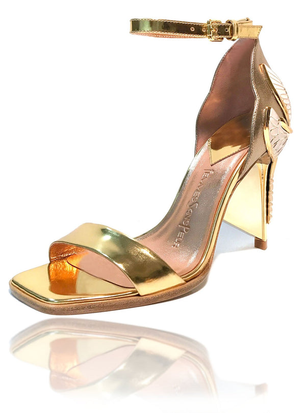"Signature Aurora Dragonfly Queen sandals in gold baby calf leather and gold mirror leather, a square toe, black leather welt, adjustable buckle ankle strap, gold mirror extended heel breast and Swarovski crystals in her tail with gold 4"" or 100mm heel."