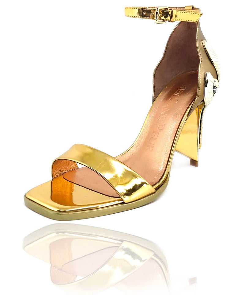 "Signature Aurora Dragonfly Queen sandals in dark gold metallic baby calf leather with gold mirror leather, a square toe, black leather welt, adjustable buckle ankle strap, gold mirror extended heel breast and Swarovski crystals in her tail with gold 4"" or 100mm heel."