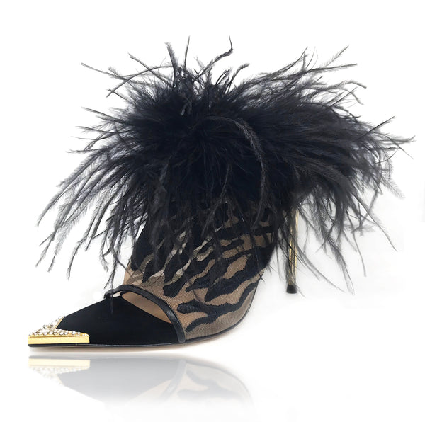 Donna mules in nude mesh embroidered with a rich black tiger stripes pattern and luxurious black ostrich feathers cascade around her topline. Black baby calf leather piping and a gold metal toe rand featuring clear inlaid Swarovski crystals that will have her glittering with every step. A rubber pod recessed into the sole helps prevent slipping on the go. There is a 4'' or 100mm gold metal stiletto heel.
