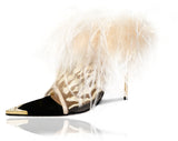 Donna mules in nude mesh embroidered with a rich ivory tiger stripes pattern and luxurious ivory ostrich feathers that cascade around her topline. Black baby calf leather piping and a gold metal toe rand featuring clear inlaid Swarovski crystals that will have her glittering with every step. A rubber pod recessed into the sole helps prevent slipping on the go. There is a 4'' or 100mm gold metal stiletto heel.