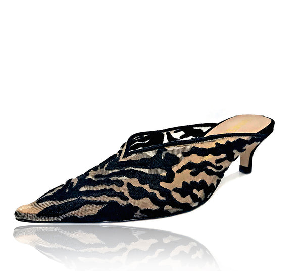 "Heidi is a pointed toe mule detailed with rich embroidered mesh in a seductive tiger pattern. A rubber pod is recessed into the sole to help prevent slips on the go. 1"" or 25mm heel."