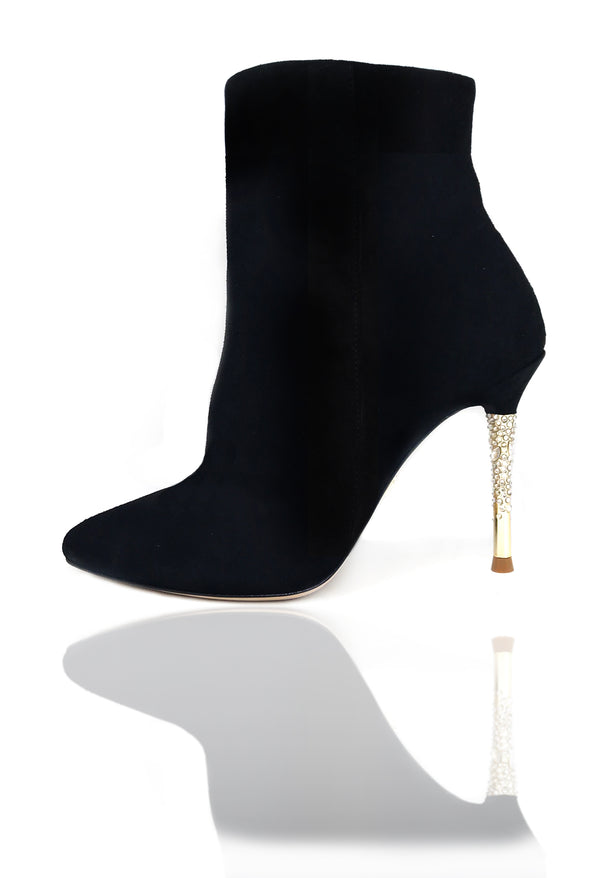 "Nadine is a pointed toe bootie with an opulent heel featuring clusters of Swarovski crystals that glitter while you walk. A rubber pod is recessed into the outsole to prevent slips. 4"" or 100mm silver metal heel and hidden inside zipper."