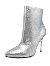 "Nadine is a pointed toe bootie with an opulent heel featuring clusters of Swarovski crystals that glitter while you walk. Her upper features hand-painted glitter leather. A rubber pod is recessed into the outsole to prevent slips. 4"" or 100mm silver metal heel and hidden inside zipper."