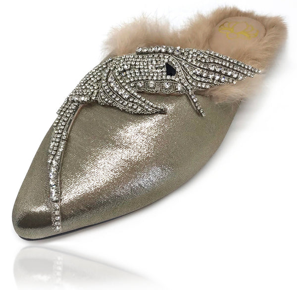 Sadira silk mule features an almond toe. Embellished with tiny hand-placed encased Swarovski crystals, the precious hummingbird ornament lays delicately on this silhouette. Lined with genuine rabbit fur you feet will be cozy all day. There is also a rubber pod recessed into the sole to help prevent slipping on the go.