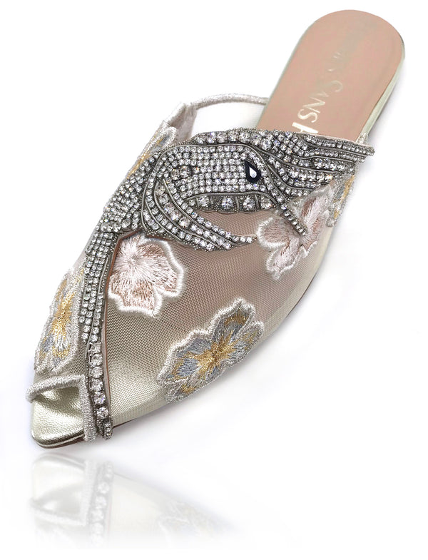 Sadira mesh mule features an almond toe. Embellished with tiny hand-placed encased Swarovski crystals, the precious hummingbird ornament lays delicately on this silhouette. Surrounded by embroidered flowers adorning the foot as elegant jewelry, you will be glittering like diamonds at dusk. There is also a rubber pod recessed into the sole to help prevent slipping on the go.