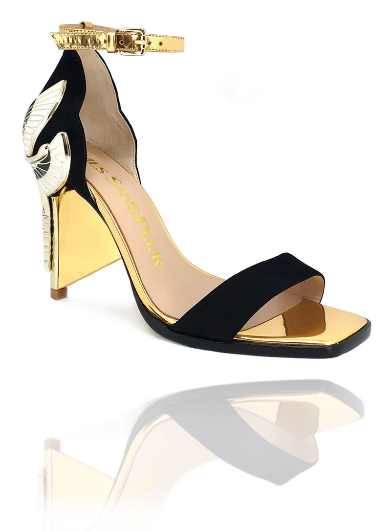 "Signature Aurora Dragonfly Queen sandals in black kid suede with gold mirror leather, a square toe, black leather welt, adjustable buckle ankle strap, gold mirror extended heel breast and Swarovski crystals in her tail with gold 4"" or 100mm heel."