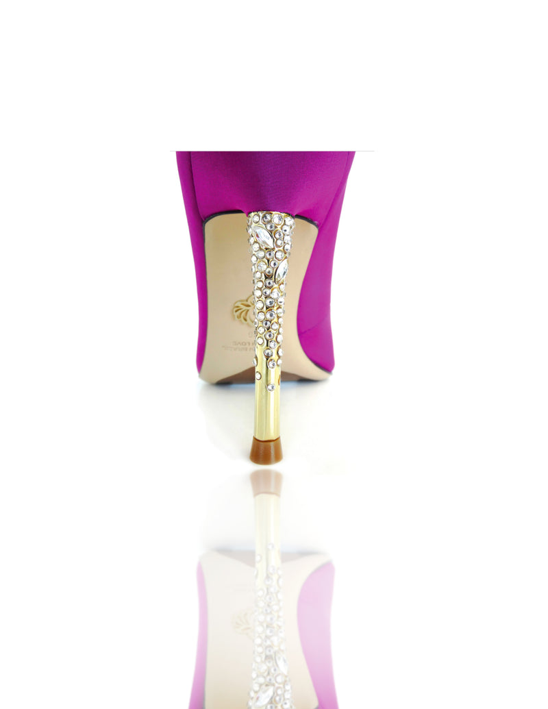 "Nadia is a pointed toe pump with an opulent heel featuring clusters of Swarovski crystals that glitter while you walk. A rubber pod is recessed into the outsole to prevent slips. 4"" or 100mm gold metal heel."