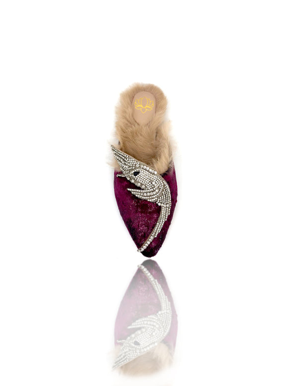 Sadira velvet mule features an almond toe. Embellished with tiny hand-placed encased Swarovski crystals, the precious hummingbird ornament lays delicately on this silhouette. Lined with genuine rabbit fur you feet will be cozy all day. There is also a rubber pod recessed into the sole to help prevent slipping on the go.