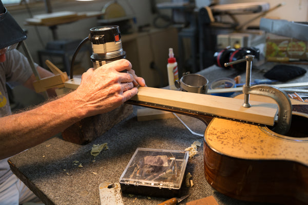 Lining up the Jig on a Guitar Repair at Mass Street Music