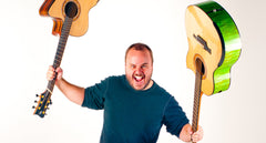 Andy McKee weilding two guitars
