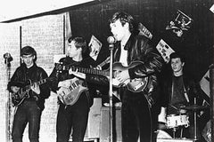 Young Beatles olaying instruments