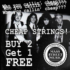 Cheap guitar strings at Mass Street Music