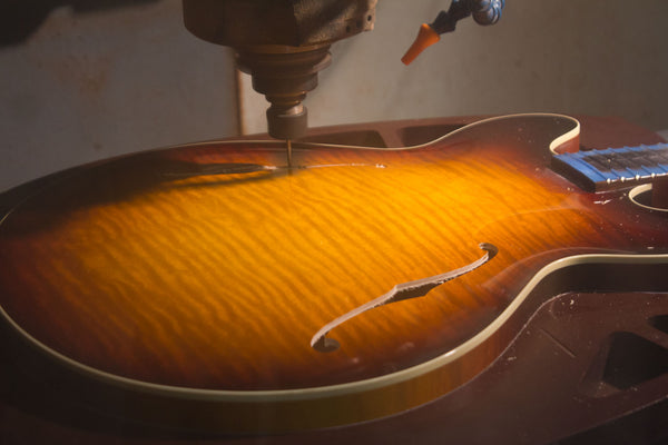 CNC machine at Collings guitars drilling f hole in I35LC -2
