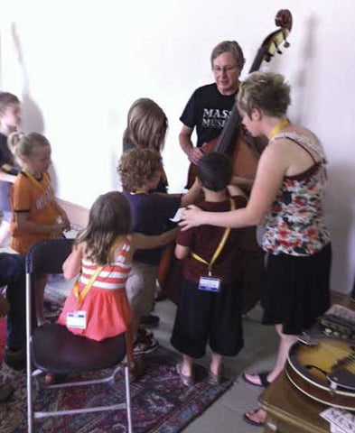Jim Baggett with Americana Music Academy kids