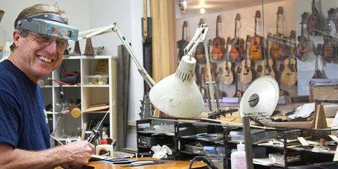 Jim Baggett working at his luthiery bench