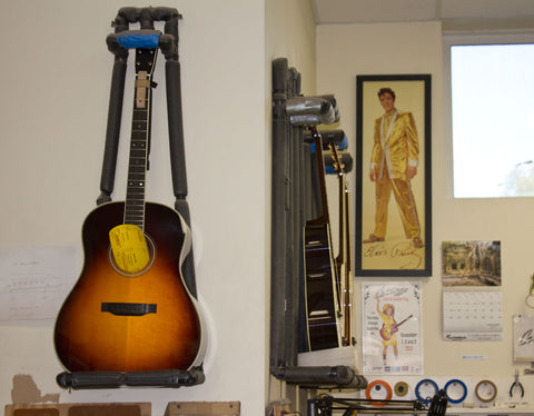 cool posters and a sweet Collings burst guitar at the collings factory