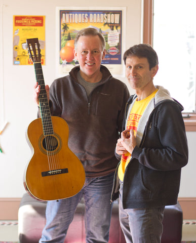 Nye and luthier Mike Horan with restored vintage Washburn guitar