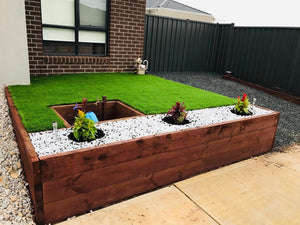 sythentic turf and pebbles retaining wall kandklandscaping