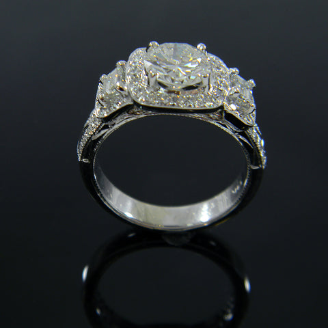 Cushion Shaped Top with Round Center Diamond Flanked by 2 Emerald Cut Diamonds