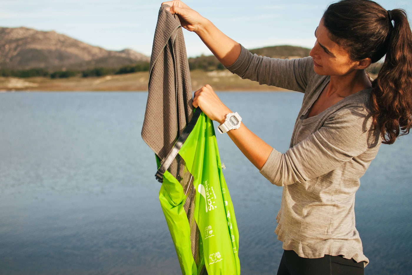 Women using Scrubba in lake