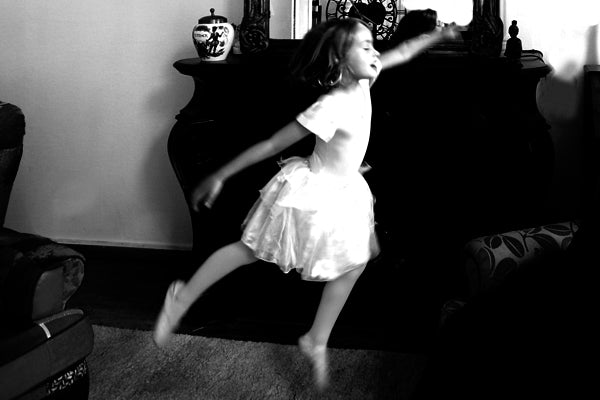 Ballerina dancing in the Ines Gloves company