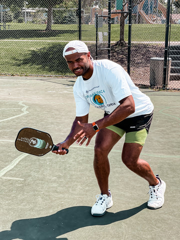 pickleball player with revolin sports paddle hitting forehand drive