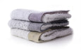 Kontex Palette Towels (stack of blue and yellow towels)
