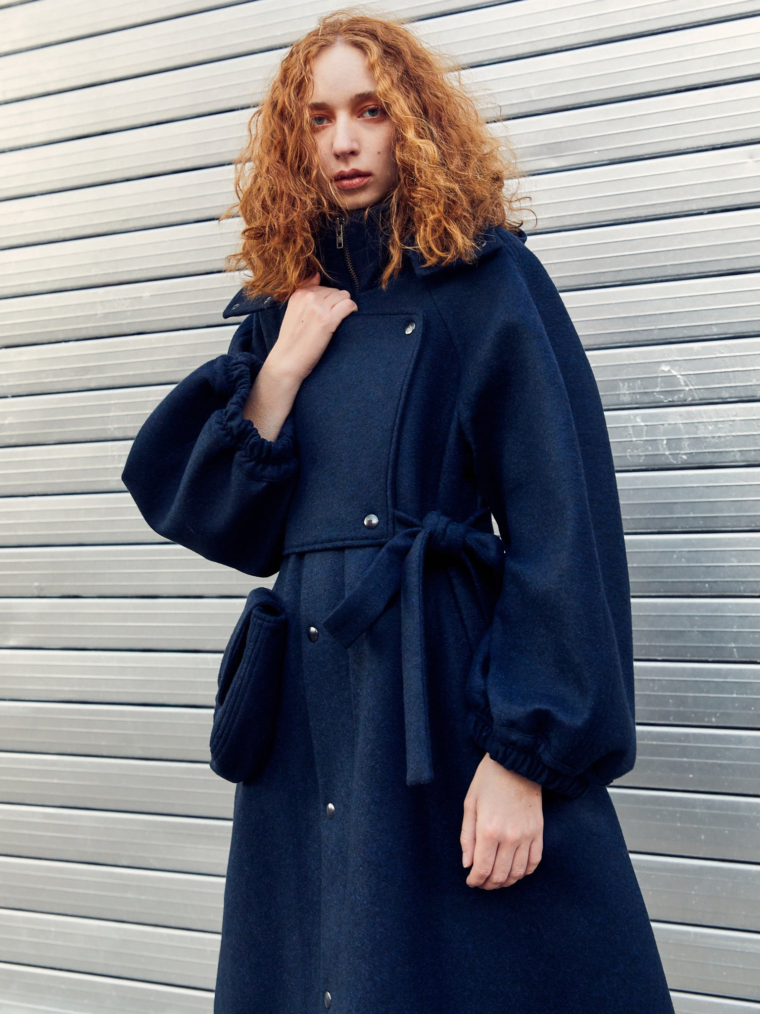 Navy wool coat with stand collar by Henrik Vibskov