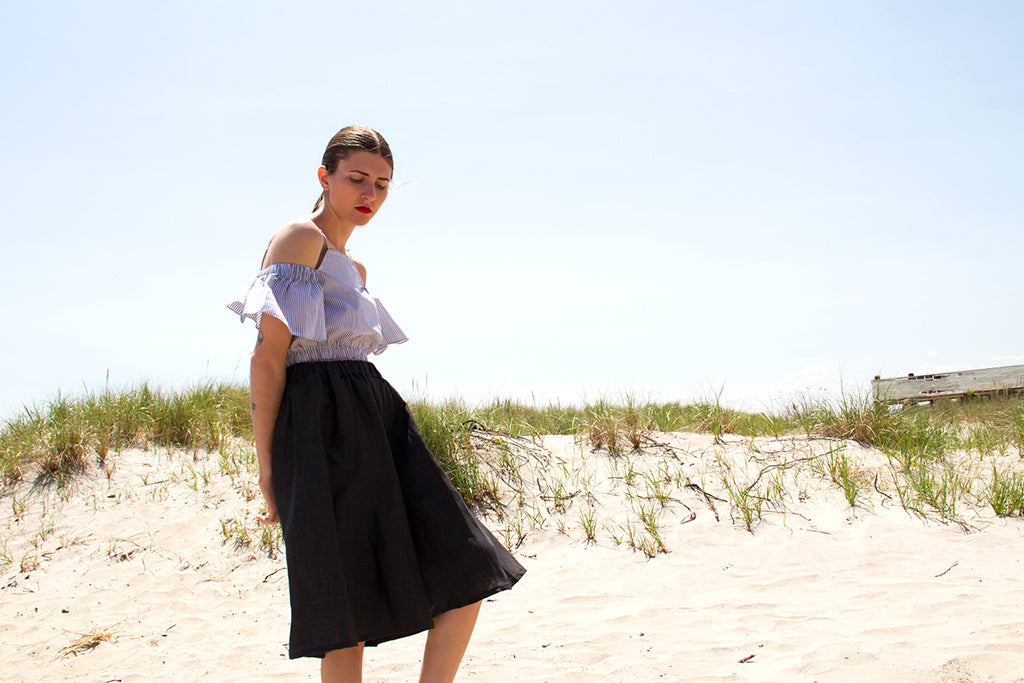 Black oversized culottes on the beach