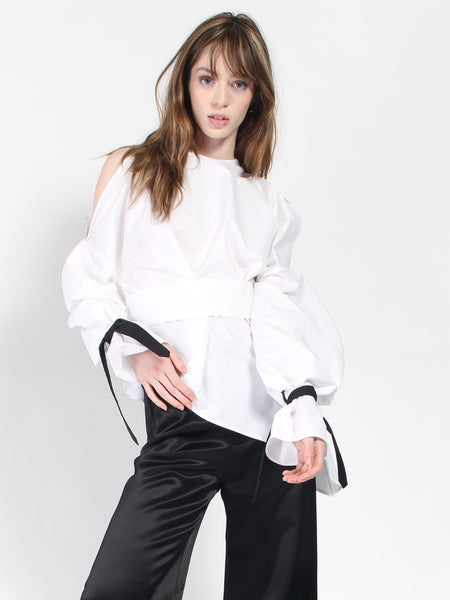 Cold Shoulder Peplum Shirt by Ji Oh
