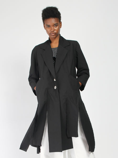 Slashed Hem Trench by Nancy Stella Soto