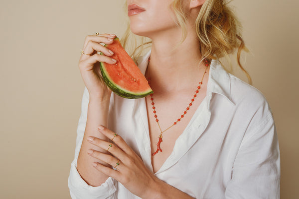 Magda for Love Is wearing layered 18ct gold tsavorite rings