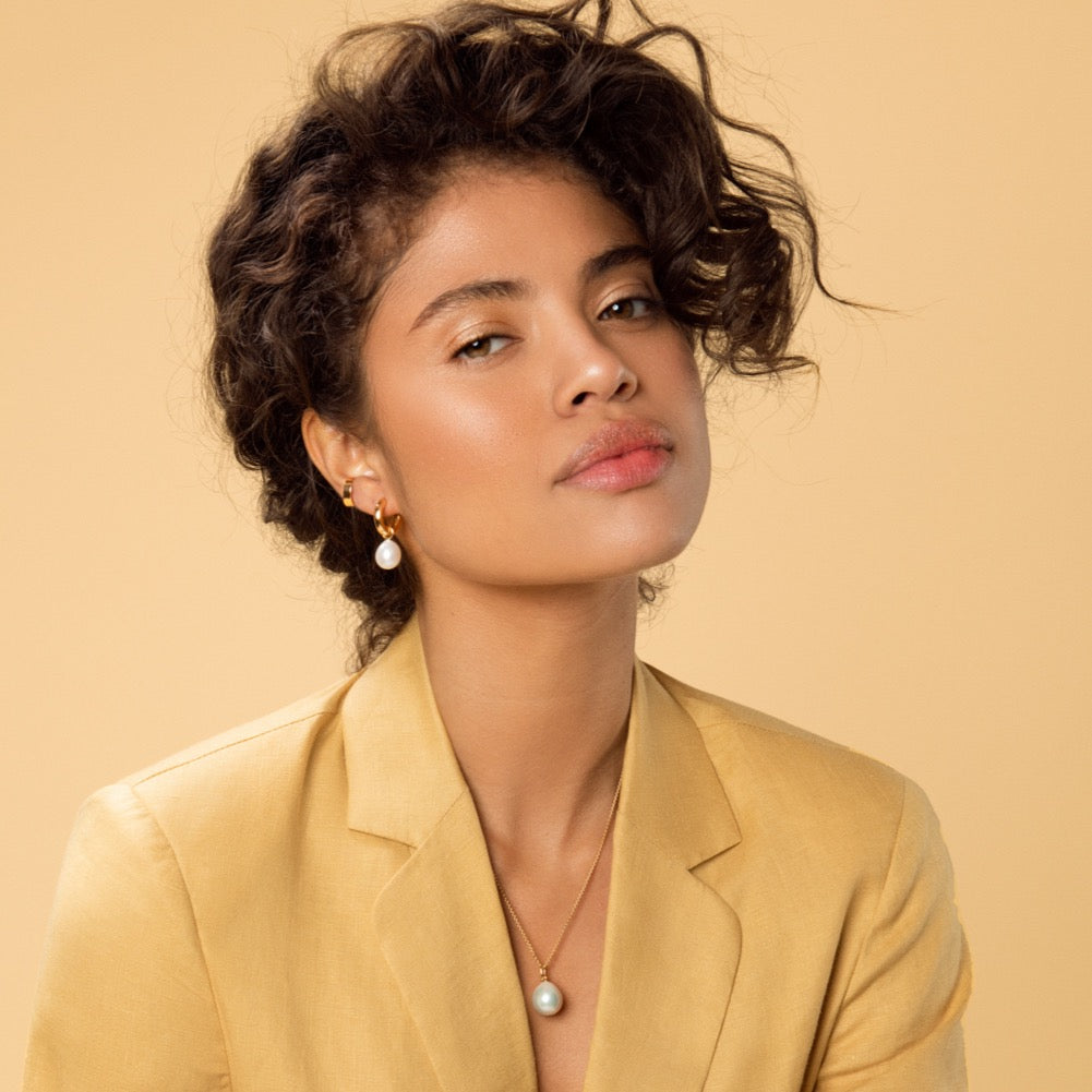 Carolini wearing Gold Ear Cuff, Chunky Polished Gold Hoop Earrings with Pearl Pendants and our Baroque Pearl Necklace.
