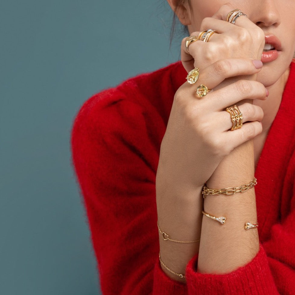 Lilian wearing the Lemon Duet Ring, the Triple Little Phalanx Ring, the Link Chain Necklace worn as a bracelet, the Diamond Carpus Bangle, the Heart Bracelet and the Diamond Studded Bracelet by McFarlane Fine Jewellery