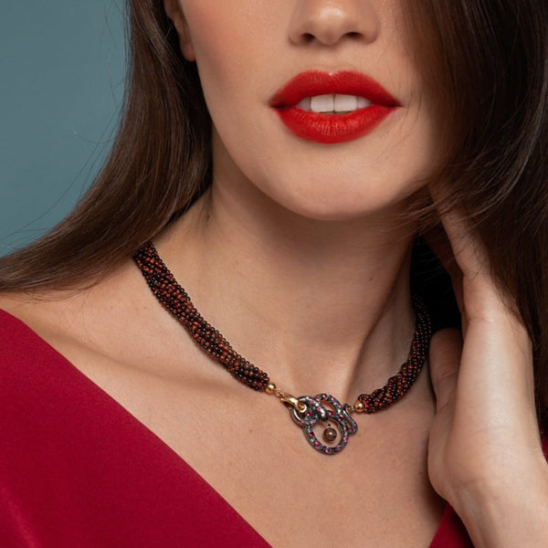 Lilian wearing the Black Snake and Red Tiger Eye Necklace by McFarlane Fine Jewellery