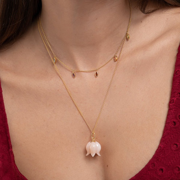 Lilian wearing the Pink Opal Bellflower Necklace and Marquis Necklace by McFarlane Fine Jewellery