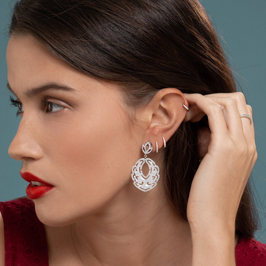 Lilian wearing the Diamond Lotus & White Jade Earrings, White Gold Diamond Huggies Medium and the White Gold Diamond Huggy Small by McFarlane Fine Jewellery