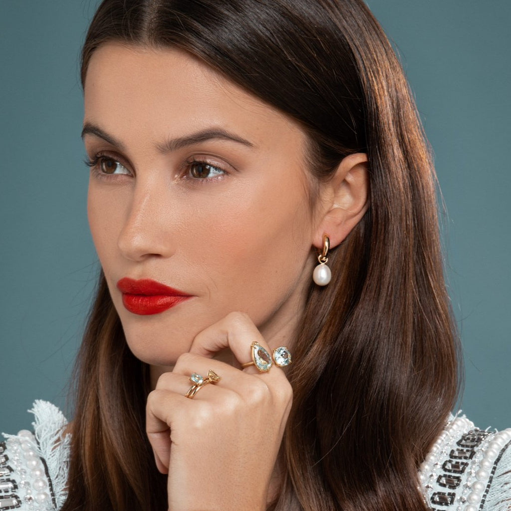 Lilian wearing the Chunky Polished Hoops with Pearls, Aquamarine Duet Ring and the No. 2 and No. 3 Candy Coloured Rings by McFarlane Fine Jewellery