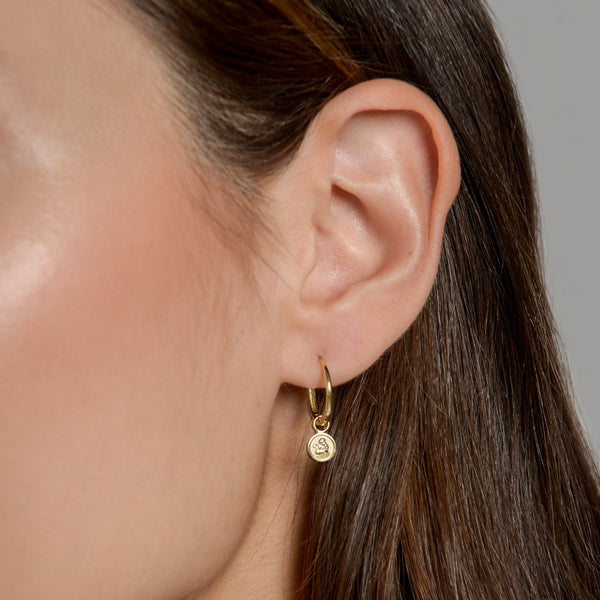 Anna wearing our Angel Earring Pendant with our 18ct Gold Closed Hoop by McFarlane Fine Jewellery