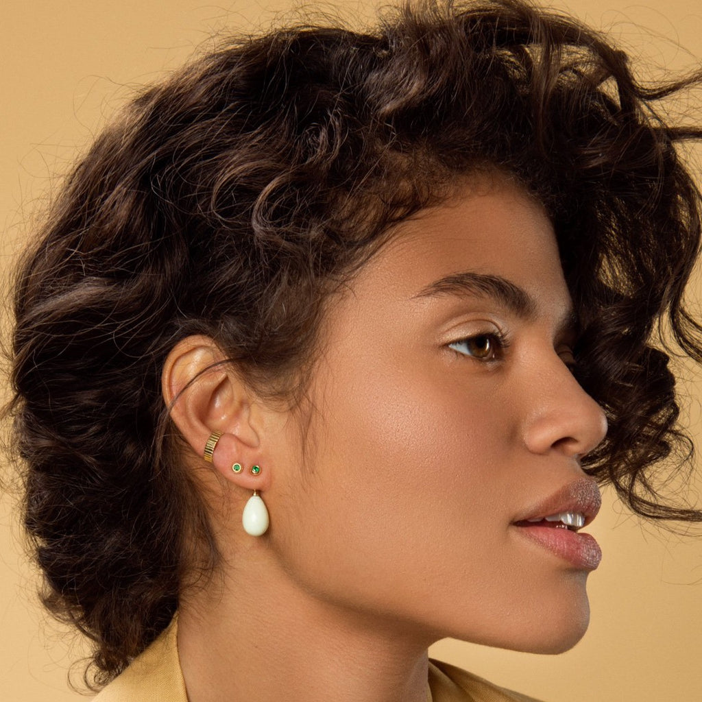 Carolini wearing our emerald studs, carved ear cuff and lemon chrysoprase earring pendants by McFarlane Fine Jewellery